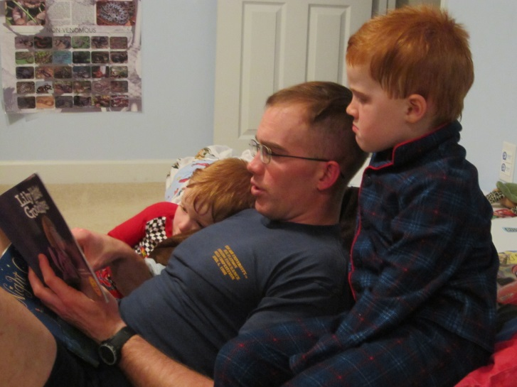 Dad reading to sons